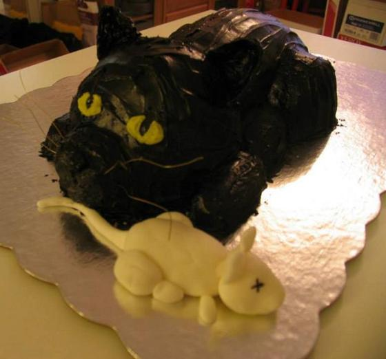 Kitsch Confections - Black cat cake made from butter cake with dyed chocolate icing and fondant mouse