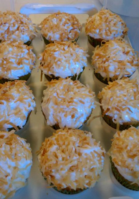 Kitsch Confections - Classic coconut cake cuppies with white icing and toasted coconut on top